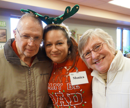 Senior couple having fun at adult day care with volunteers at Clement Manor