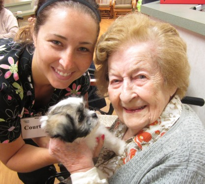 Seniors Having Pet Visits with help from skilled nurses at Clement Manor