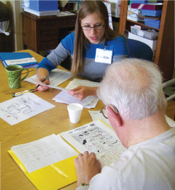senior doing brain stretch activities for memory recall at clement manor