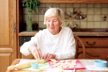 memory care resident making cookies